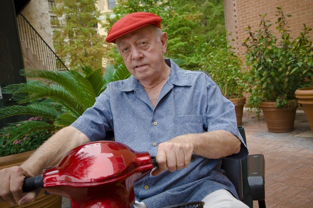 a senior man on a scooter