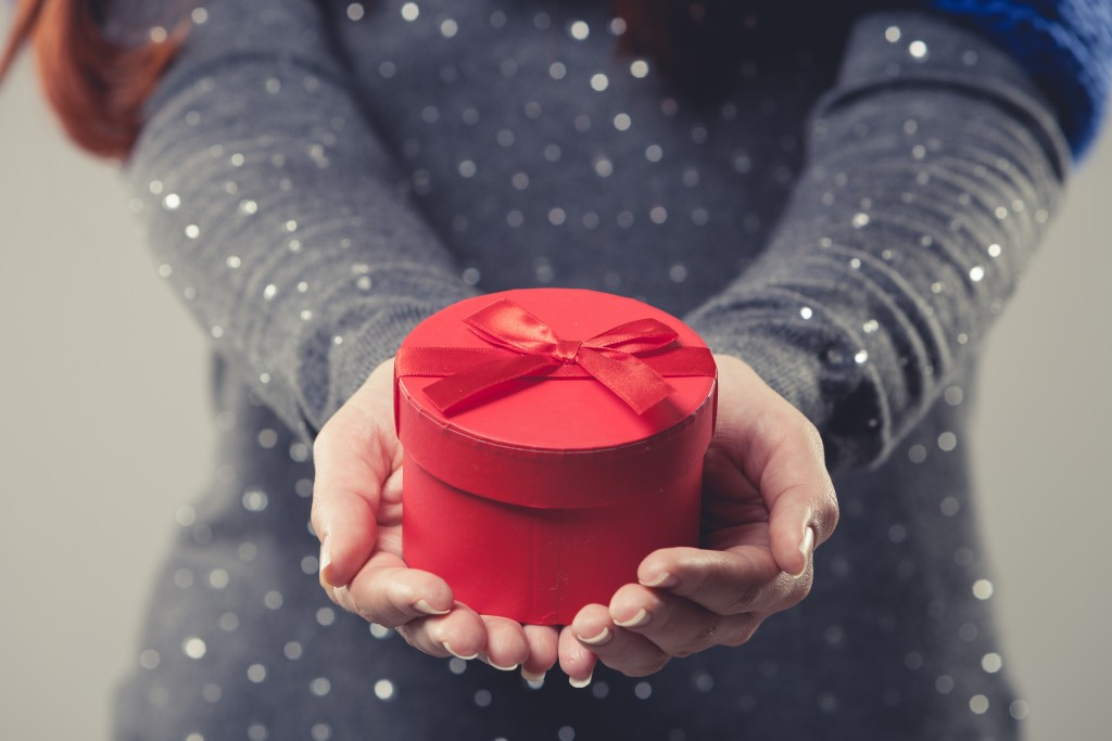 Woman holding a round gift box
