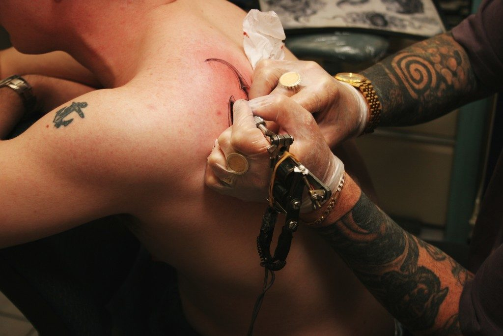 man getting tattoo