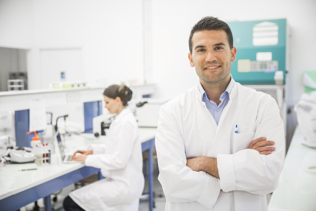Male scientist posing with his arms crossed