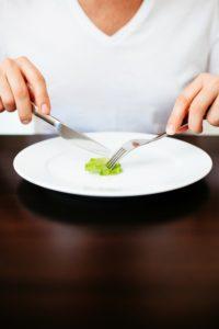 Man eating small lettuce
