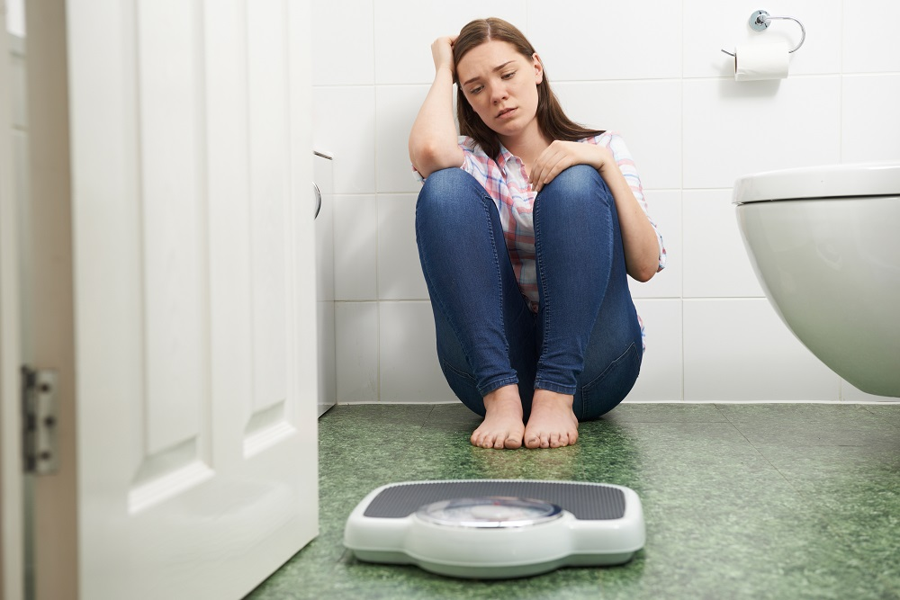 Woman scared of weighing scale