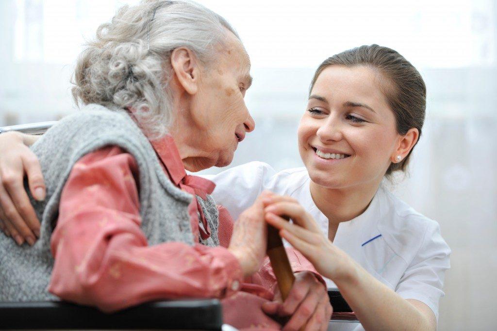Caregiver smiling at her patient
