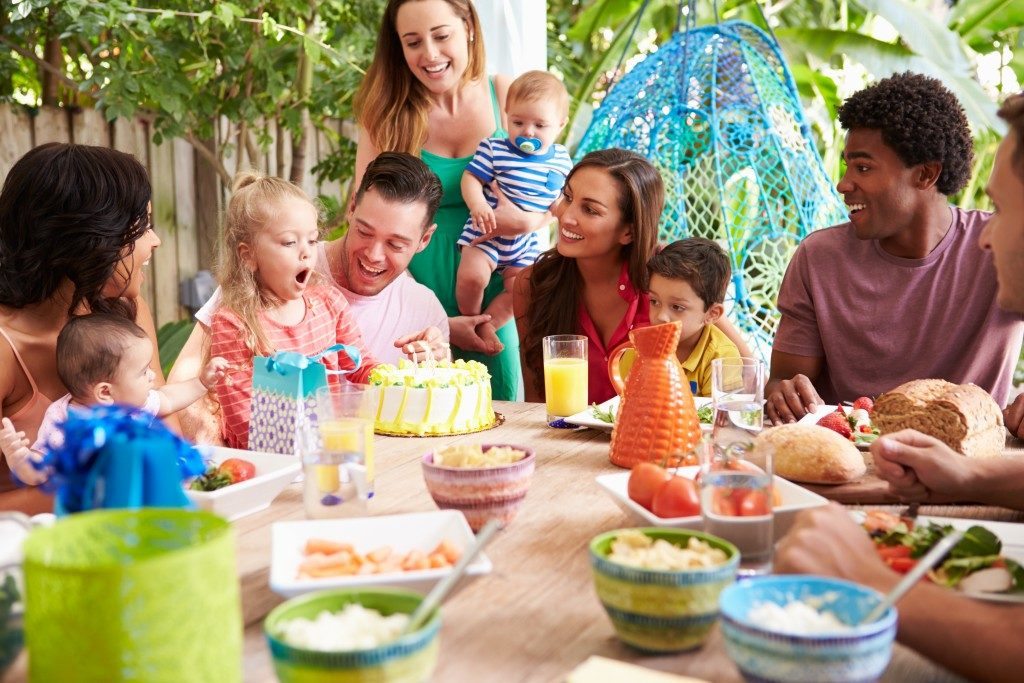Family celebrating kid's birthday party