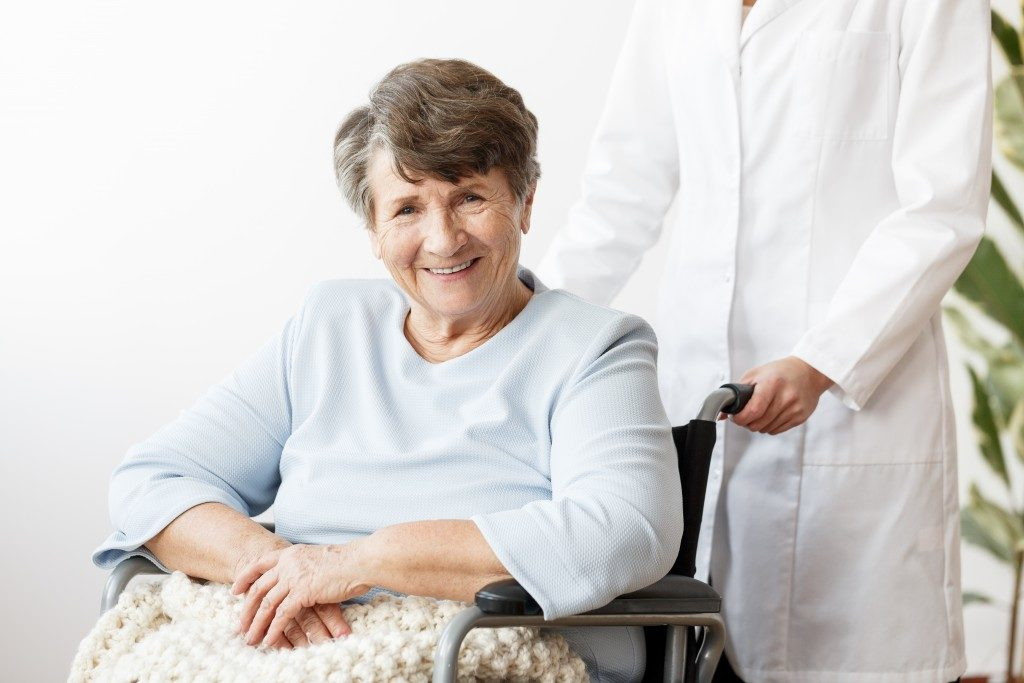 Elderly on wheelchair smiling