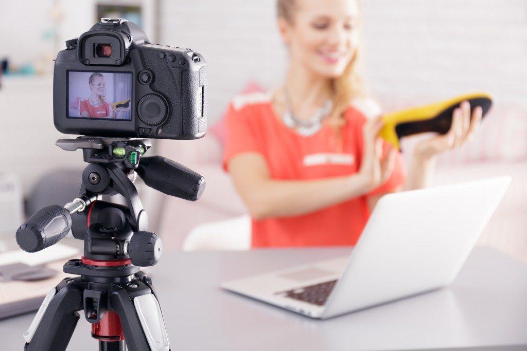 woman taking a video log