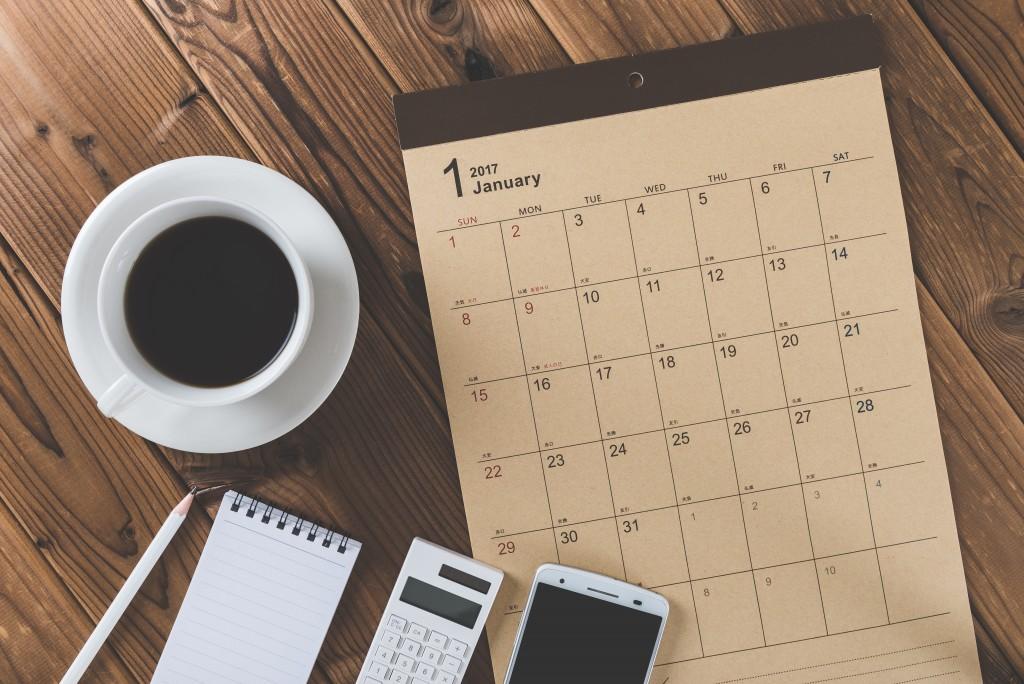 work calendar with items on the desk