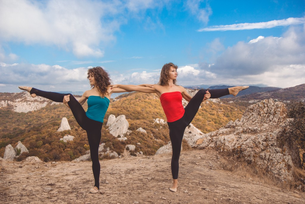 two girls doing yoga