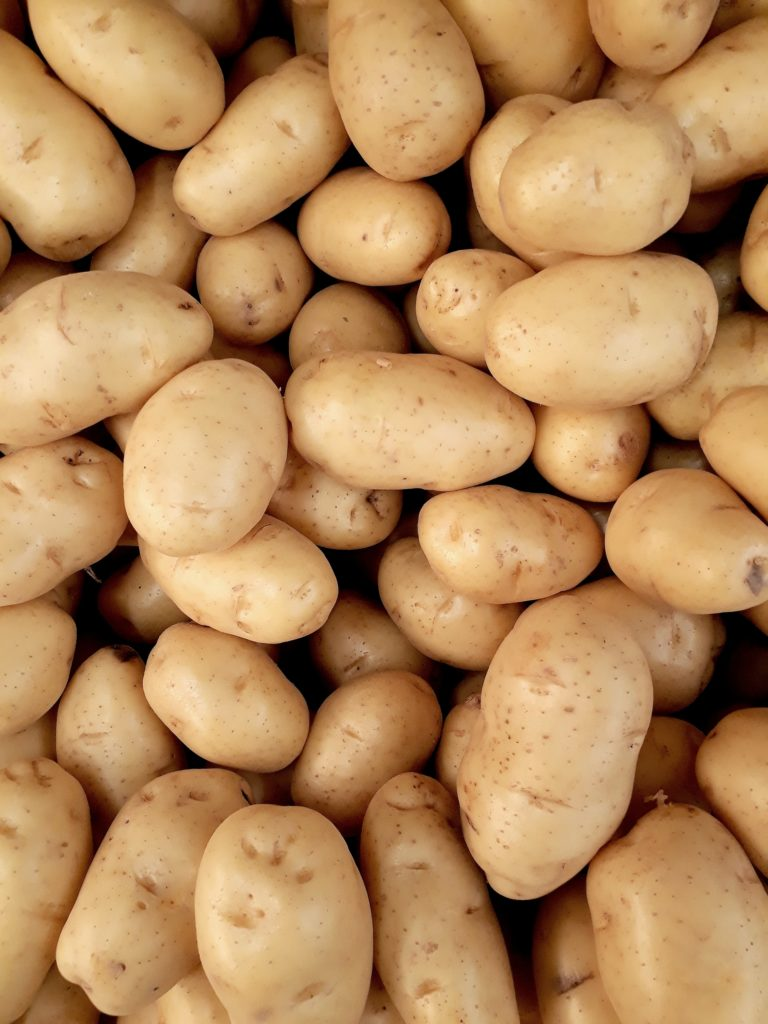 bunch of unpeeled potatoes