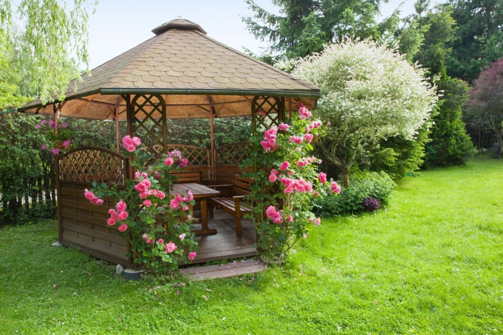 gazebo with roses on a lawn